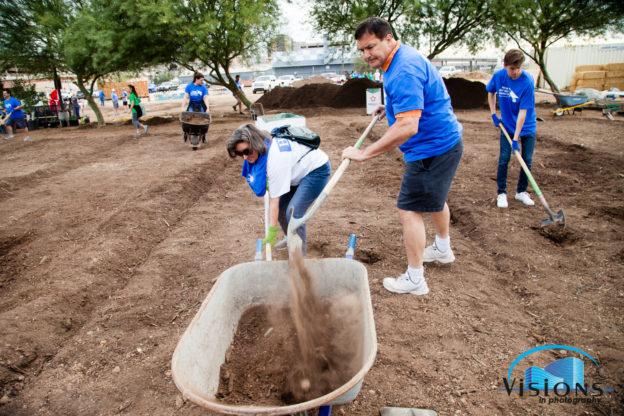 NAI Horizon's Jeff Adams shovels dirt at the 2017 Valley Partnership Community Project.